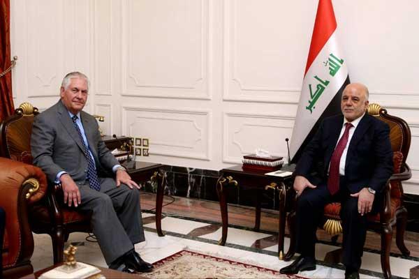 العبادي وتليرسون خلال اجتماعهما في بغداد