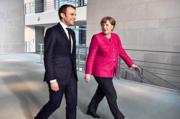 المستشارة الألمانية والرئيس الفرنسي خلال لقائهما في برلين