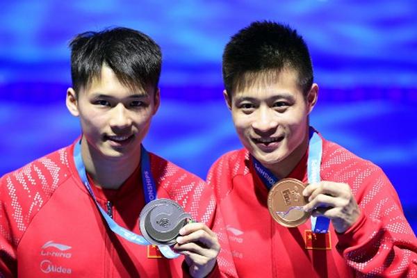 انهت الصين منافسات الغطس في بطولة العالم للسباحة بذهبية ثامنة عبر وانغ هان ولي جينغ