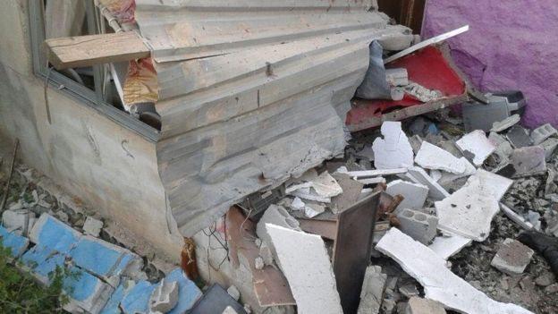 آثار التدمير في أعقاب الهجمات الانتحارية في السويداء