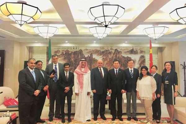 صورة جماعية على هامش المباحثات التي عقدت في الصين