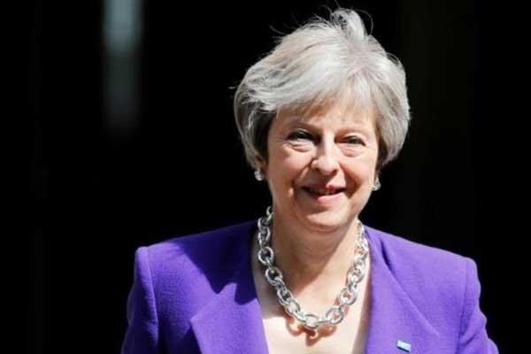 رئيسة الحكومة البريطانية تيريزا ماي في لندن في 4 يوليو 2018