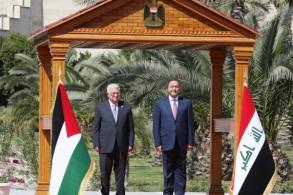 الرئيسان العراقي والفلسطيني لدى عزف السلام الوطني لبلديهما