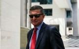 مستشار الأمن القومي السابق للرئيس دونالد ترمب مايكل فلين يغادر محكمة في واشنطن - 24 يونيو 2019