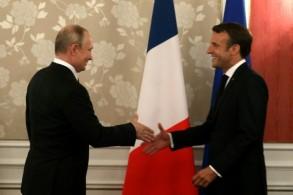 الرئيس الفرنسي ونظيره الروسي خلال قمة مجموعة العشرين في أوساكا في 28 يونيو 2019