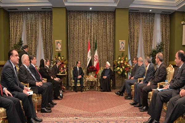 الوفدان العراقي برئاسة المالكي والايراني برئاسة روحاني خلال اجتماعهما في طهران