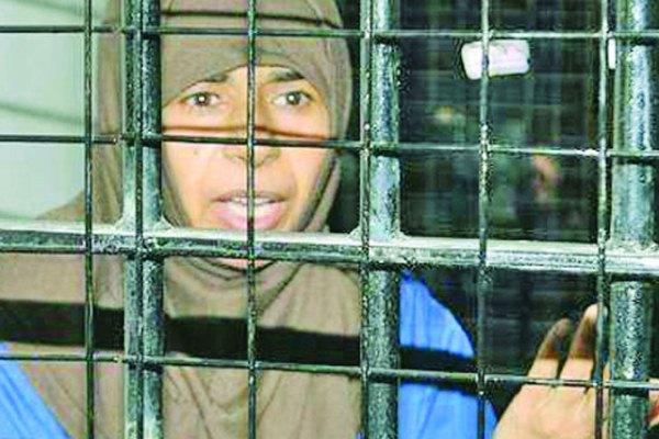 ساجدة الريشاوي وراء القضبان في سجن أردني