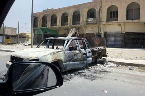 آثار المعارك في أحد شوارع الموصل