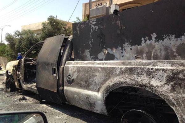 عربة عسكرية محترقة في الموصل