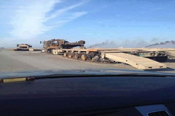 ناقلة دبابات محترقة في الموصل
