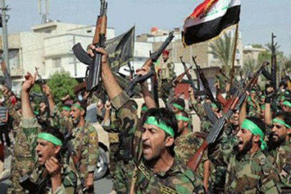 مقاتلون عراقيون في ميليشا الحشد الشعبي