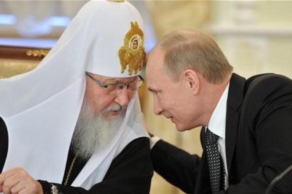 بوتين مع بطريرك الكنيسة الروسية كيريل