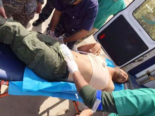 صحافي عراقي مصاب برصاص داعش