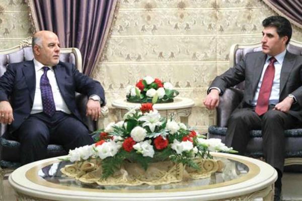 العبادي ونجيرفان بارزاني خلال اجتماع سابق في بغداد