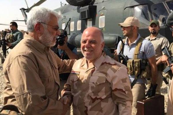 العبادي مع المهندس في جبهة القتال ضد داعش
