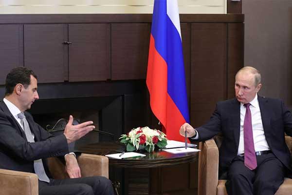 بوتين مستمعا لحديث بشار خلال اللقاء المفاجىء