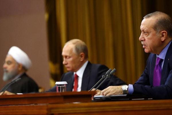 بوتين يتوسط اردوغان وروحاني خلال القمة