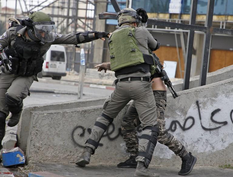 جانب من المواجهات في رام الله يوم الجمعة
