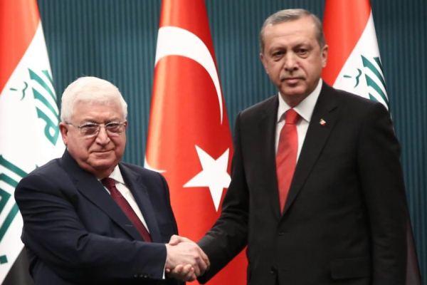 الرئيسان العراقي معصوم والتركي إردوغان خلال لقاء سابق