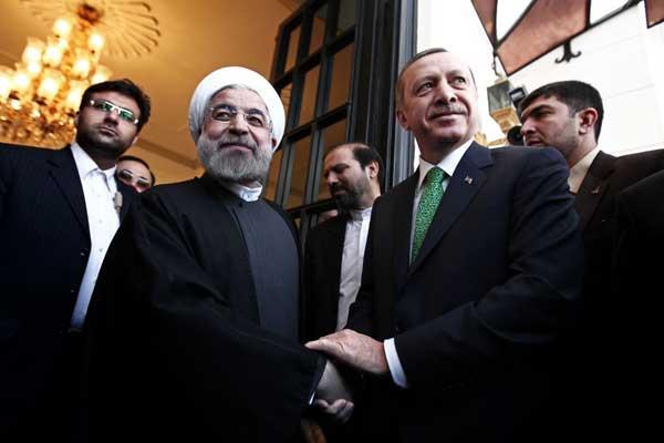 أردوغان وروحاني خلال لقاء سابق - أرشيفية