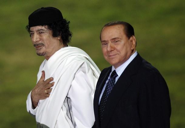 القذافي مع سيلفيو برلسكوني رئيس الوزراء الايطالي السابق - أرشيفية