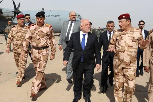 العبادي لدى وصوله الى الموصل