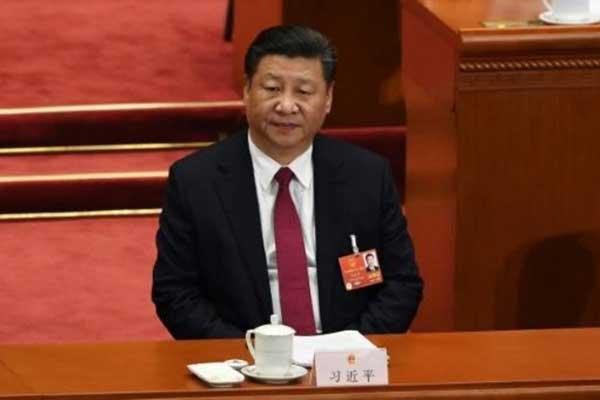 الرئيس الصيني شي دينبينغ في الجمعية الوطنية الشعبية في بكين في 9 مارس 2018