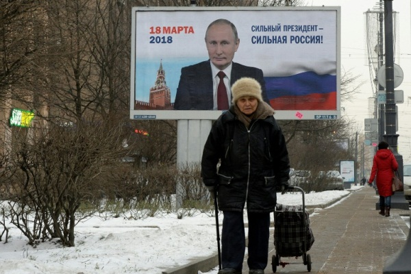 لافتة تحمل شعار بوتين الانتخابي