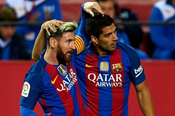 الأرجنتيني ليونيل ميسي و الأوروغوياني لويس سواريز نجما نادي برشلونة الإسباني