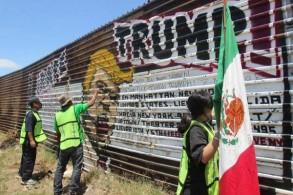 على الحدود المكسيكية... مهاجرون محتجون على خطة ترمب إنشاء جدار