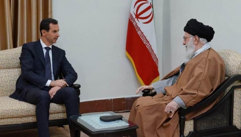 الأسد في حضرة المرشد ولا أثر لعلم الدولة السورية