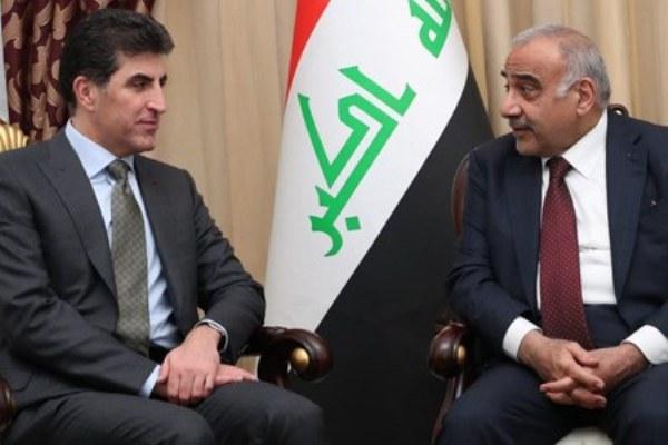 عبد المهدي ونجيرفان بارزاني خلال اجتماع سابق في بغداد