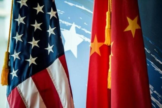 العلمان الصيني والأميركي في بكين بتاريخ 30 يونيو 2017