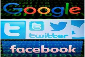 شعارات غوغل وتويتر وفايسبوك على شاشة جهاز لوحي في باريس في 29 أبريل 2018