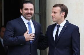 الرئيس الفرنسي إيمانويل ماكرون (يمين) ورئيس الوزراء اللبناني سعد الحريري