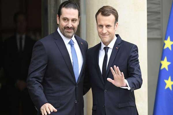 سعد الحريري وإيمانويل ماكرون خلال لقاء جمعهما في باريس في العام الماضي
