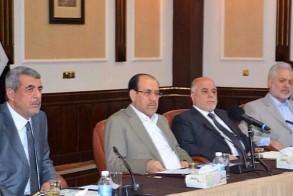 عدد من قادة حزب الدعوة يتوسطهم العبادي والمالكي خلال اجتماع مؤخرا
