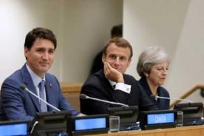 من اليسار: رئيس الوزراء الكندي جاستن ترودو والرئيس الفرنسي إيمانويل ماكرون ورئيسة الحكومة البريطانية تيريزا ماي خلال مشاركتهم في مؤتمر حول تعليم الفتيات على هامش الجمعية العامة للأمم المتحدة في نيويورك أمس 25 سبتمبر 2018