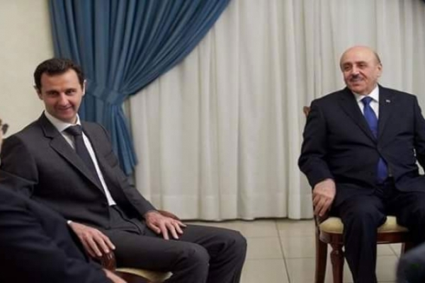 علي مملوك الى جانب الأسد في لقاء مع مسؤول إيراني