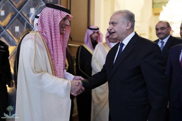 وزير الخارجية السعودي خلال استقباله وزير خارجية العراق