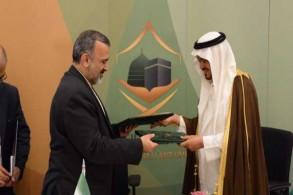 وزير الحج السعودي محمد بنتن ورئيس منظمة الحج والزيارة الإيرانية علي رضا رشيديان
