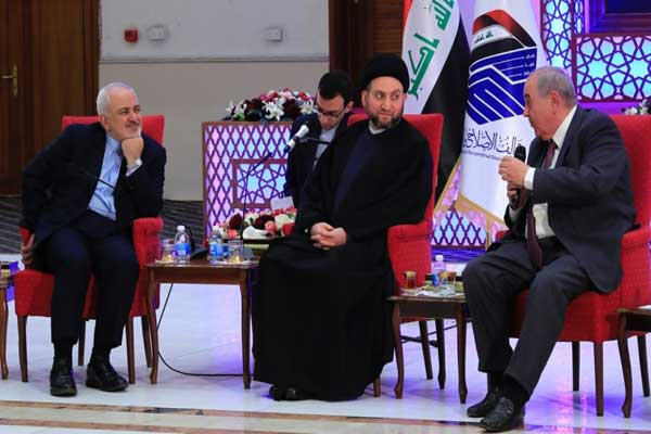 ظريف مجتمعًا في بغداد مع علاوي والحكيم