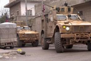 صورة مأخوذة من شريط فيديو بثه أ ف ب تي في في 16 يناير 2019 لآليات أميركية في مكان وقوع تفجير انتحاري في منبج في شمال سوريا
