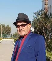 الشاعر الجزائري بوزيد حرز الله