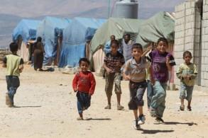 لاجئون سوريون في أحد المخيمات المخصصة لإيوائهم في لبنان