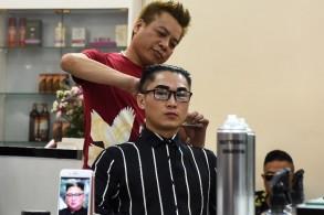 مواطن فيتنامي يقلد تسريحة شعر كيم جونغ أون