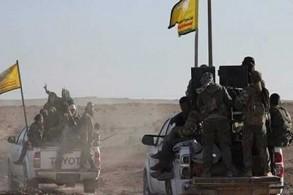 عناصر من قوات سوريا الديمقراطية الكردية