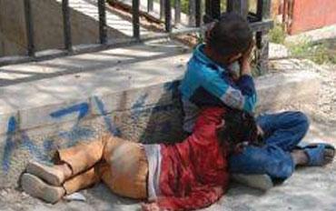 أطفال متسولون في أحد شوارع بغداد