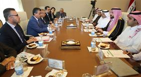فريقا التنسيق للمجلس التنسيقي العراقي السعودي خلال اجتماعهما في بغداد
