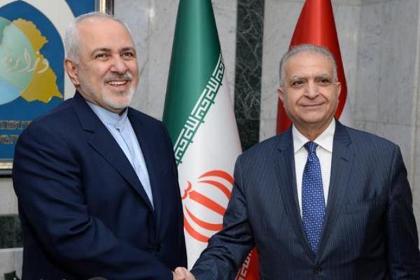 وزيرا خارجيتي العراق وايران، الحكيم وظريف، خلال لقاء سابق